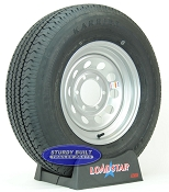 ST225/75R15 Radial Trailer Tire on a Silver Gray Mod 6 bolt Wheel